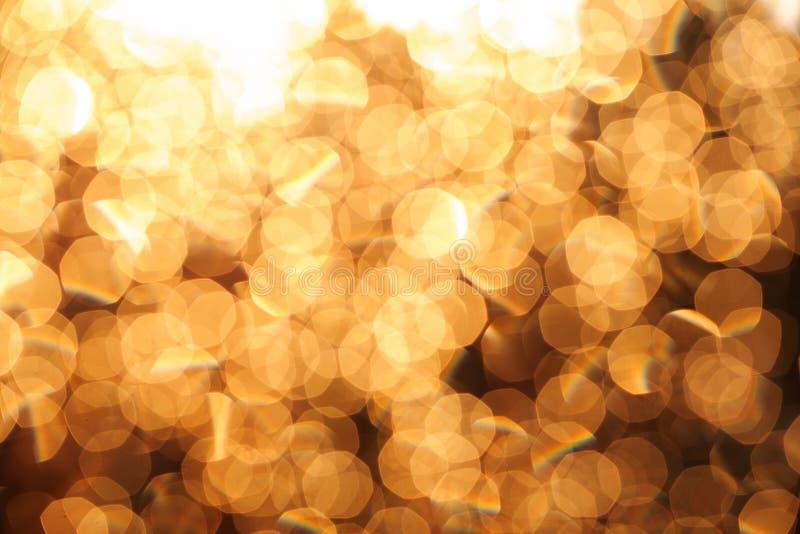 闪烁欢乐圣诞灯背景 光和金子defo 库存图片