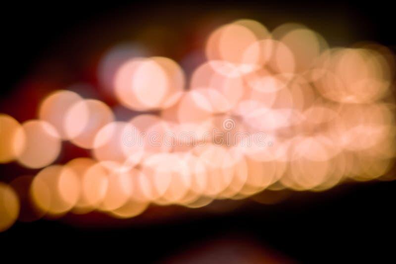 闪烁葡萄酒点燃背景 黑暗的金子和黑色 defocuse 库存图片