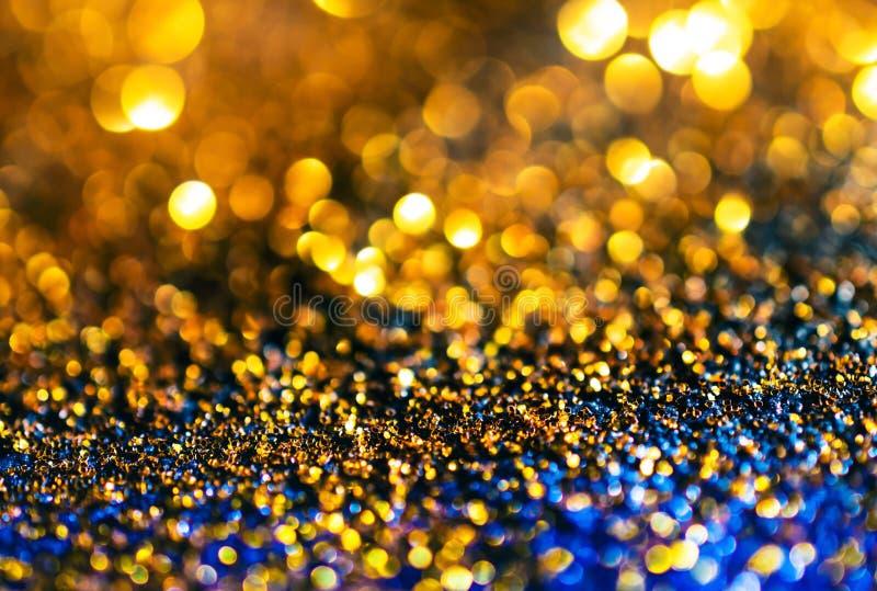 闪烁金子点燃难看的东西背景,闪烁defocused abstrac 库存照片