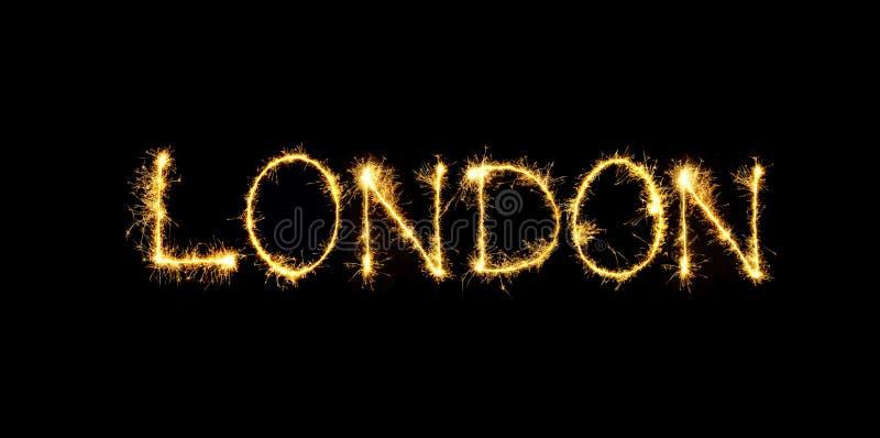 闪耀的词在黑背景隔绝的伦敦 免版税库存照片