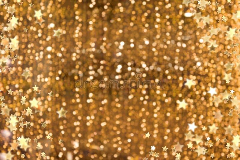 闪耀的金黄背景 库存照片