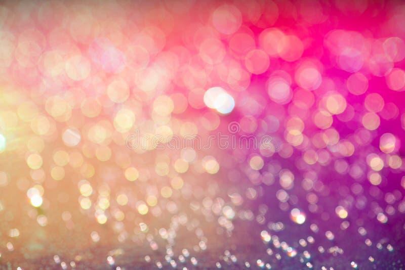 闪闪发亮的温暖金色和粉红色薄薄的彩色背景 免版税图库摄影