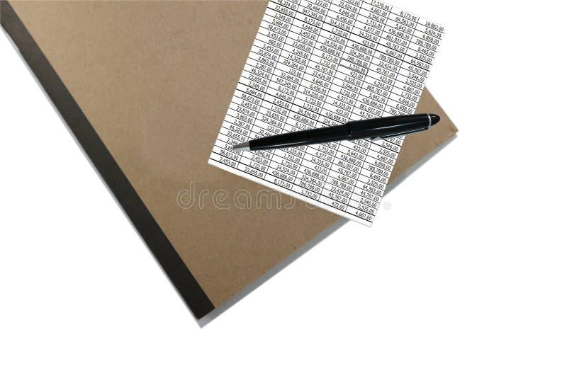 闭合的棕色盖子笔记本顶视图有笔和文件的 免版税图库摄影