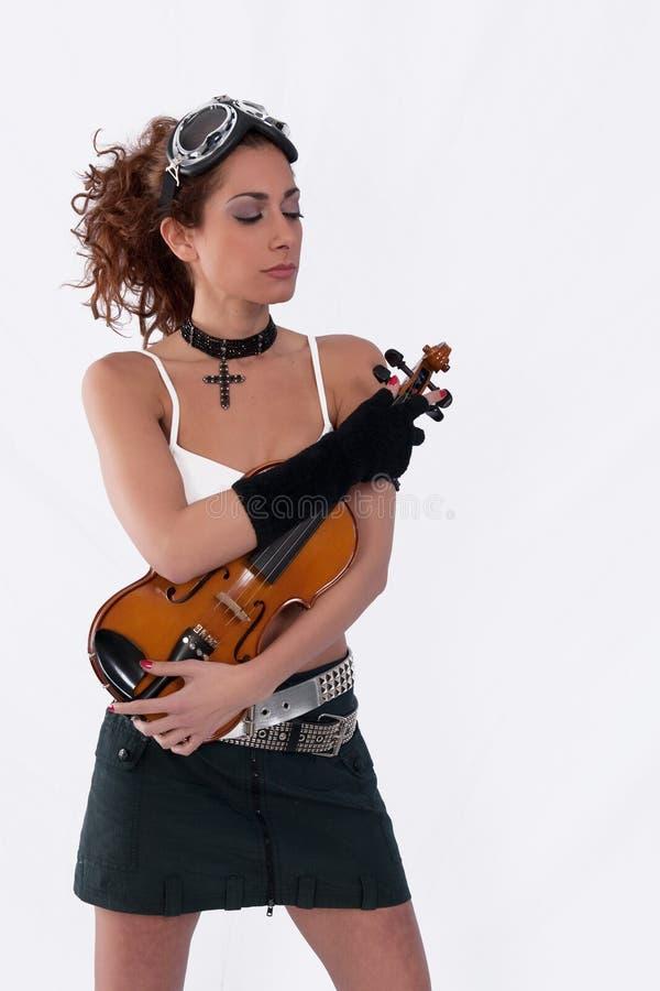 闭合的眼睛女孩风镜steampunk小提琴 库存图片