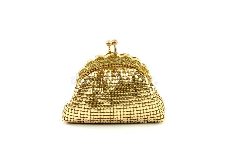 闭合的金黄钱包钱包 免版税库存图片