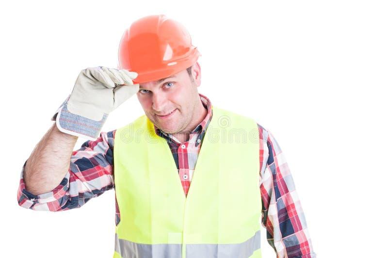 问候概念以英俊的建造者陈列尊敬 免版税库存图片