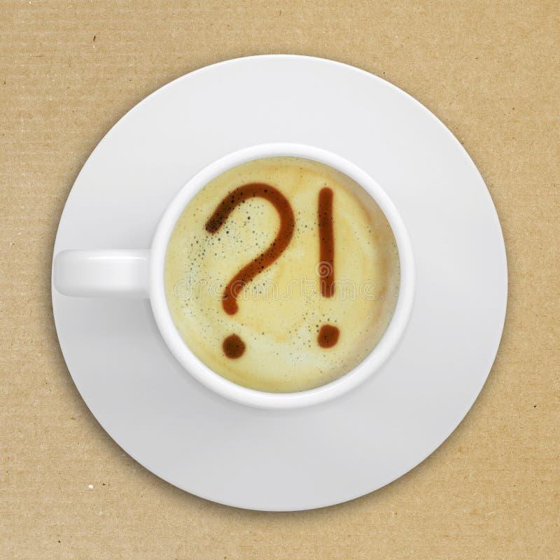 问题和惊叹号在咖啡起泡沫 免版税库存图片