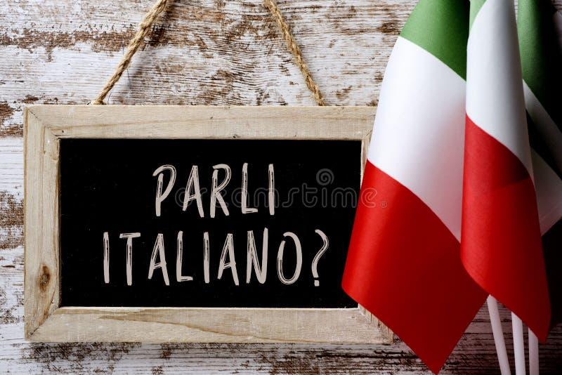 问题parli italiano ?您是否讲意大利语? 免版税库存图片