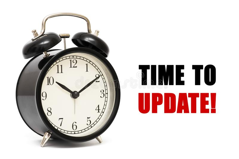 闹钟和文本时间更新 时刻更新概念 时刻更新概念在白色背景的时钟特写镜头与红色 免版税库存照片