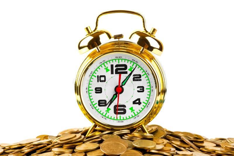 闹钟和硬币 库存照片