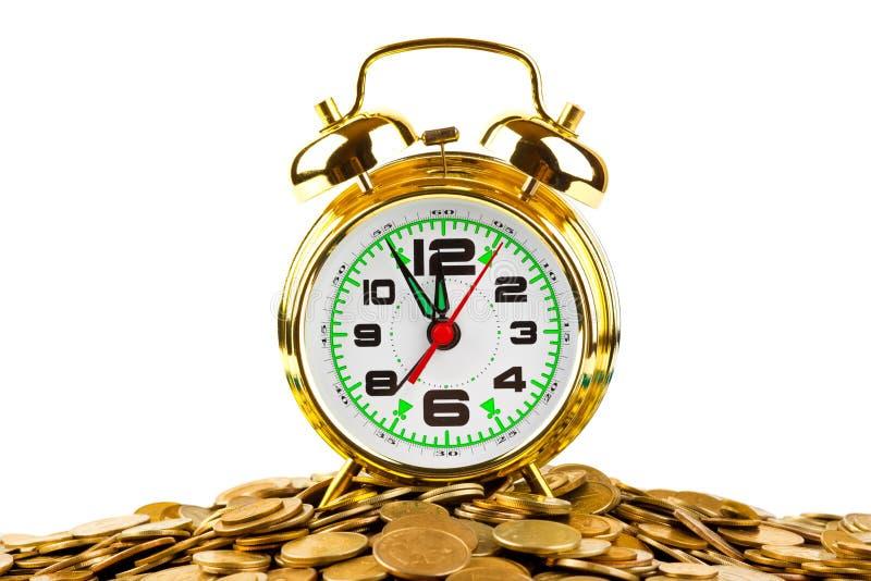 闹钟和硬币 免版税图库摄影