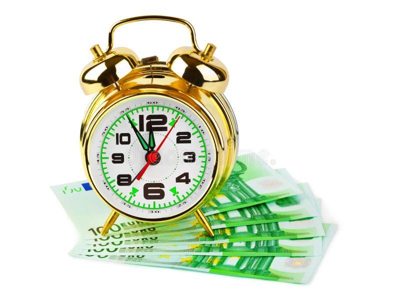 闹钟和金钱 库存照片