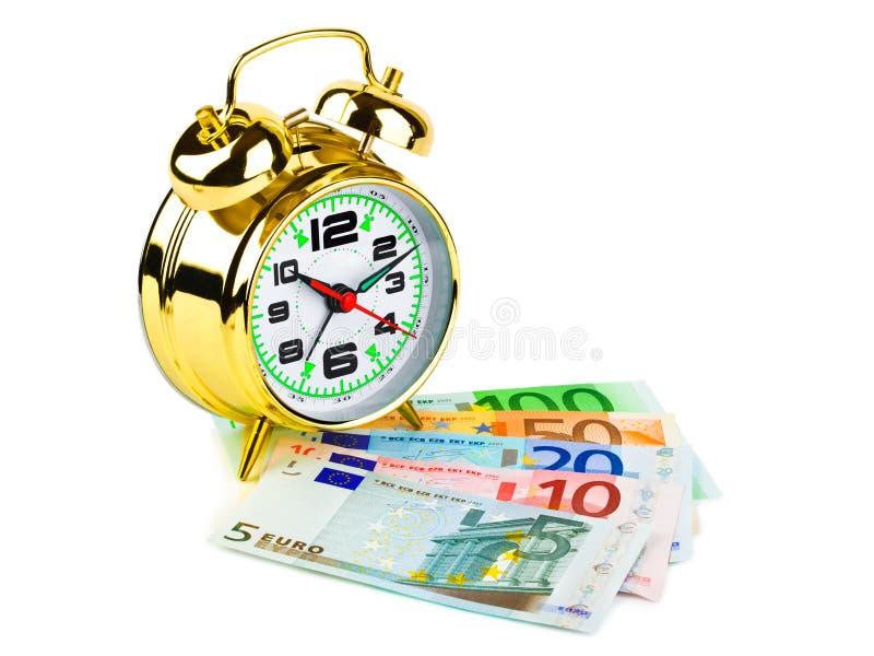 闹钟货币 库存图片
