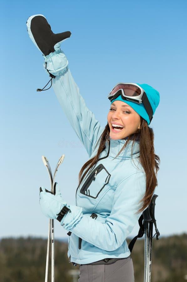 翻阅女性阿尔卑斯的滑雪者半身画象  免版税库存照片