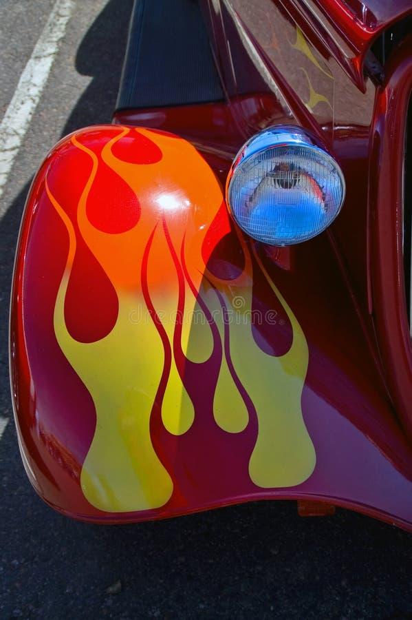 防御者发火焰马力强大的红色汽车 库存照片