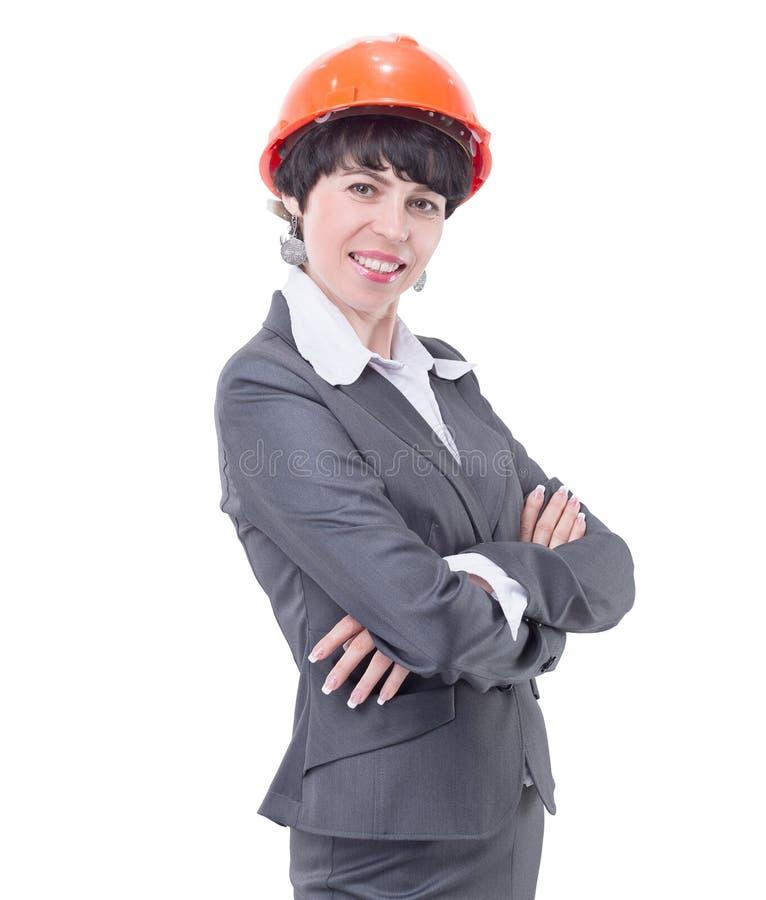 防护盔甲的微笑的妇女建筑师 E 库存照片