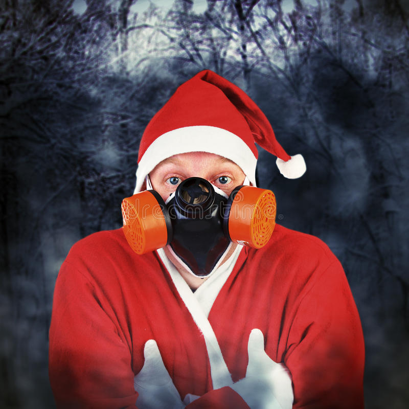 防毒面具的圣诞老人 库存图片
