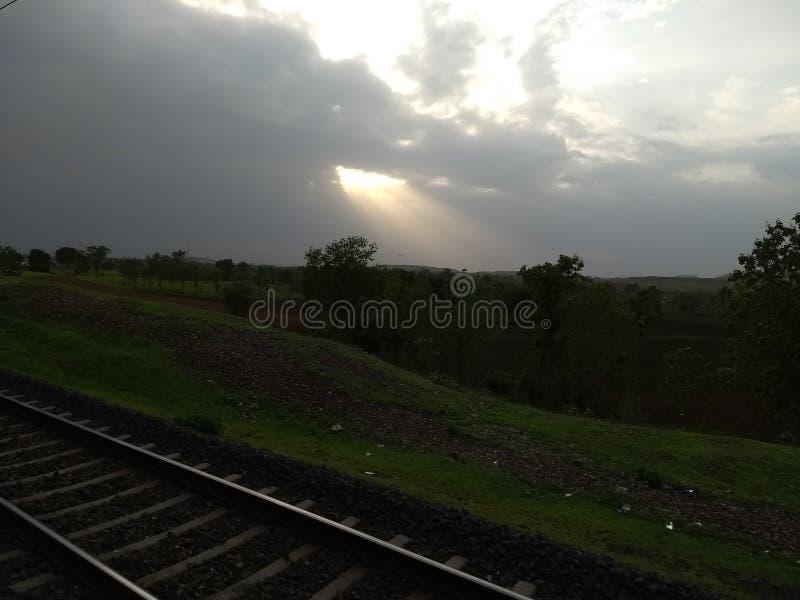 阳光云彩多雨天气 库存图片