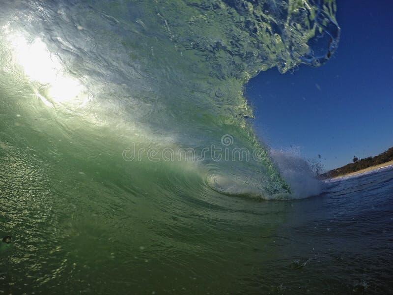 阳光光芒通过海洋 库存图片
