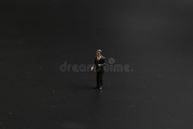 Download 阶段的有些busines人与黑暗后面地面 库存图片. 图片 包括有 小雕象, 少许, 女性, 特写镜头 - 108712757