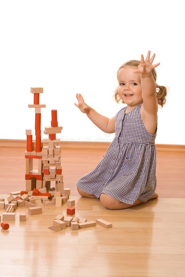 阻拦愉快的女孩木的矮小 免版税库存图片