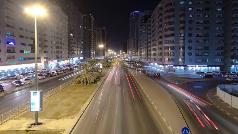 阿吉曼都市风景从桥梁的在夜timelapse 阿吉曼是阿吉曼酋长管辖区的资本在阿联酋 图库摄影