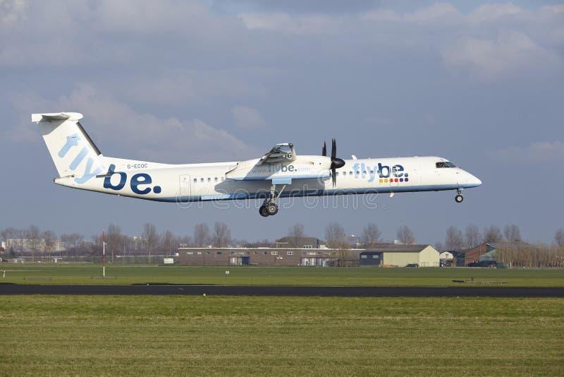 阿姆斯特丹史基浦机场- Flybe投炸弹者破折号土地 免版税库存照片