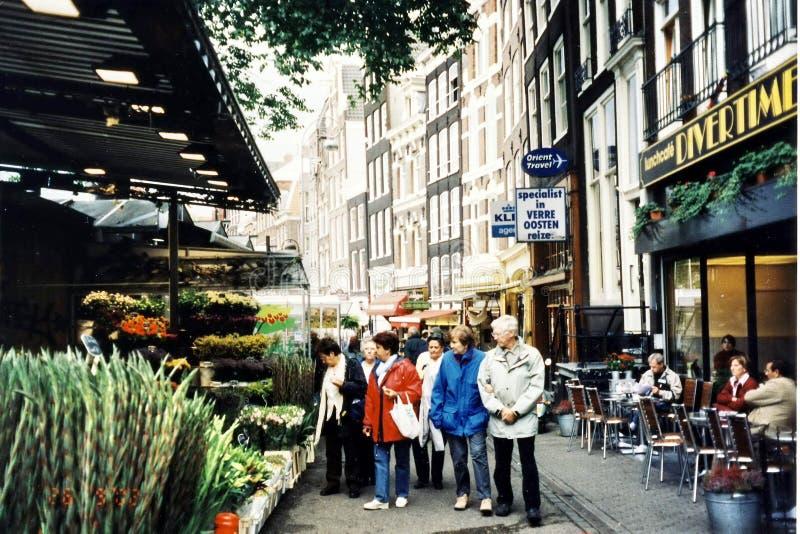 Download 阿姆斯特丹花店2002年 图库摄影片. 图片 包括有 背包, 两栖, 旅行, 销售额, 五颜六色, 商业 - 59109272