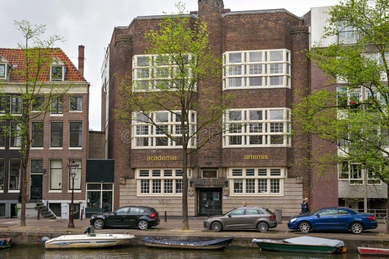 阿姆斯特丹,荷兰- 2017年6月25日:范Noortschool的老大厦在Prinsengracht街道上的 库存照片