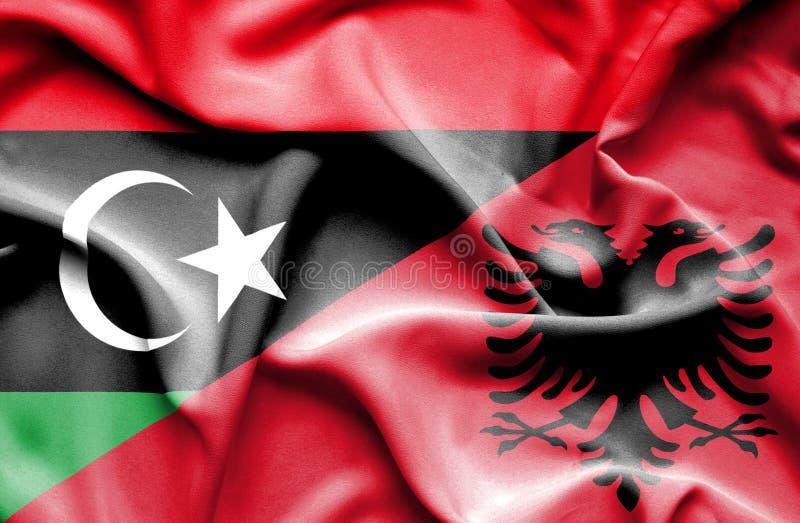 阿尔巴尼亚和利比亚的挥动的旗子 向量例证
