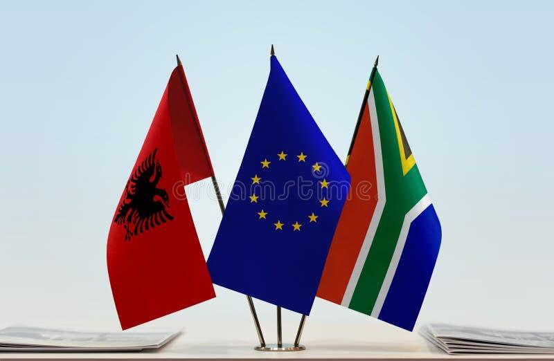 阿尔巴尼亚欧盟和南非共和国的旗子 库存图片