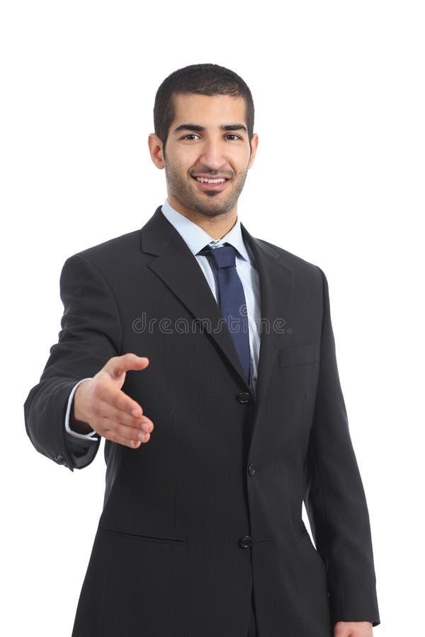 阿拉伯商人微笑准备好对握手 图库摄影