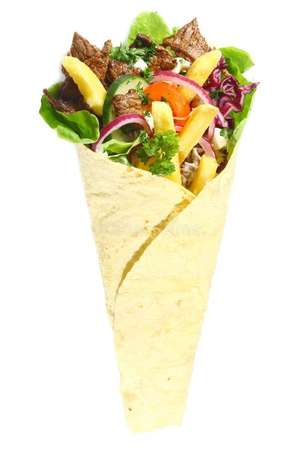 阿拉伯快餐用在皮塔饼面包包裹的肉 免版税库存图片