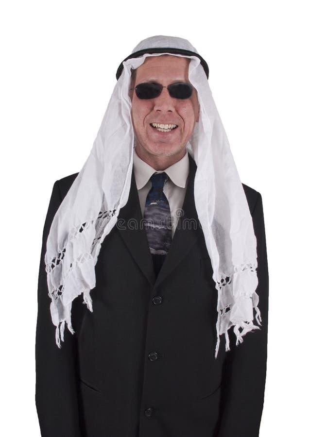 阿拉伯生意人滑稽查出的微笑 免版税库存图片