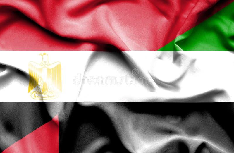 阿拉伯联合酋长国和埃及的挥动的旗子 免版税库存照片