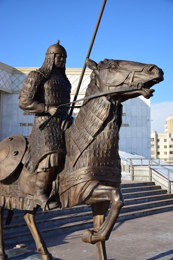 阿斯塔纳/哈萨克斯坦-以一个历史哈萨克人战士为特色的纪念碑 图库摄影