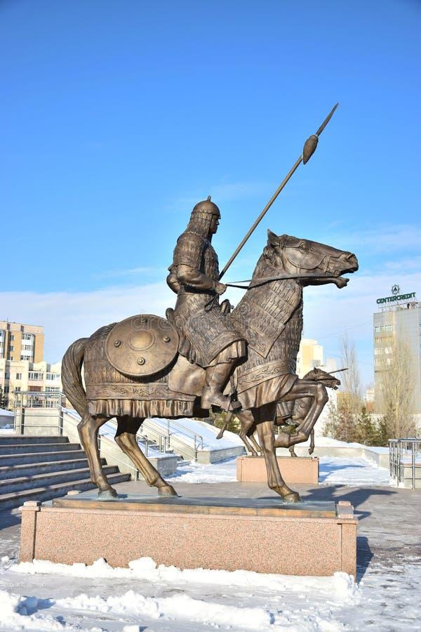 阿斯塔纳/哈萨克斯坦-以一个历史的哈萨克人战士为特色的纪念碑 免版税图库摄影