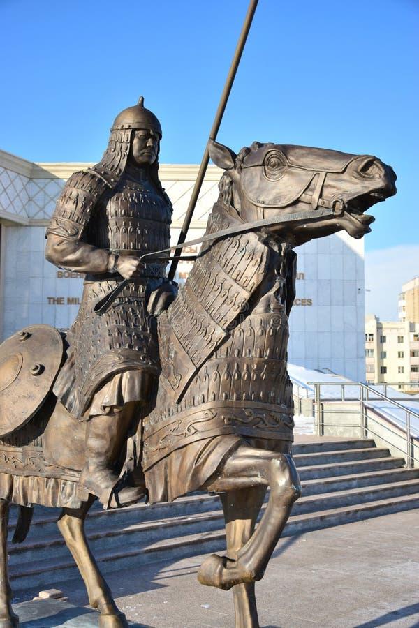 阿斯塔纳/哈萨克斯坦-以一个历史的哈萨克人战士为特色的纪念碑 免版税库存照片