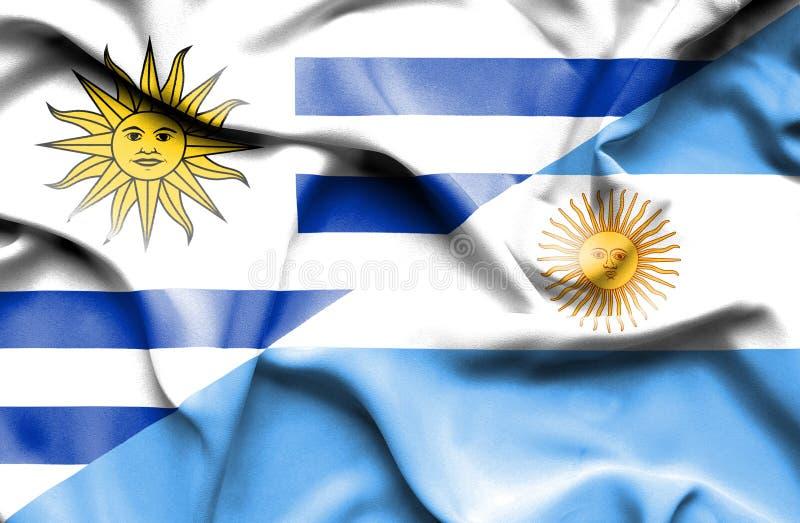阿根廷和乌拉圭的挥动的旗子 皇族释放例证