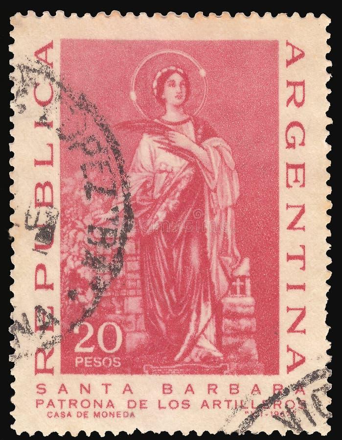 阿根廷大约1967年:阿根廷薄菏打印的被取消的邮票,显示圣徒火炮的巴巴拉女赞助者,大约 库存照片