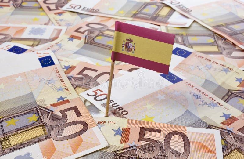 黏附在50张欧洲钞票的西班牙的旗子 (系列) 免版税图库摄影