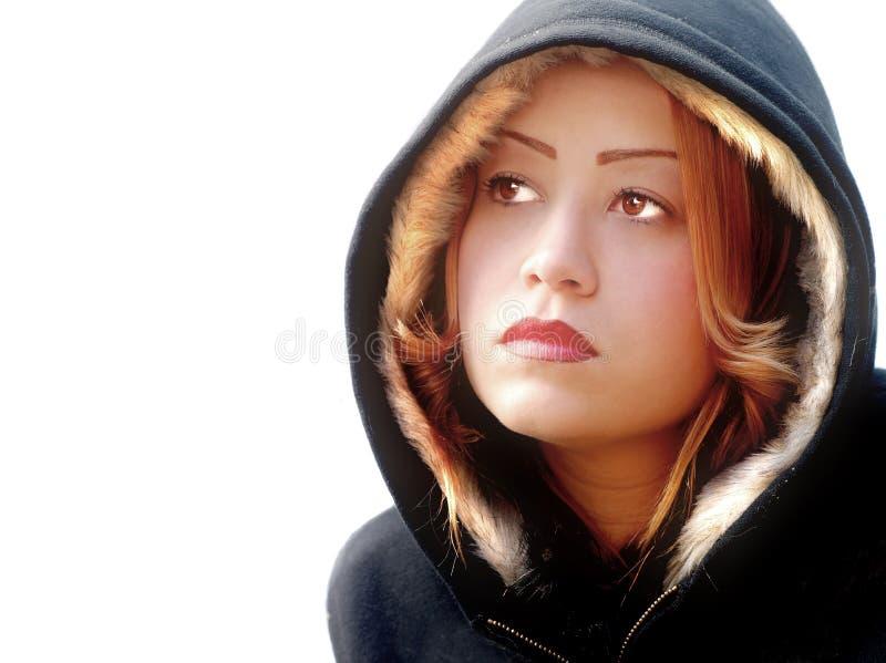 附头巾皮外衣妇女年轻人 库存图片