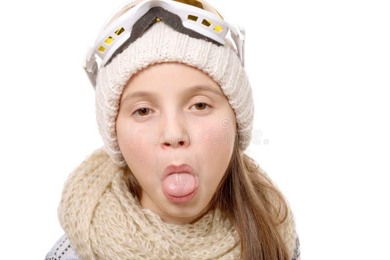 黏附她的舌头的十几岁的女孩被隔绝在白色 库存图片