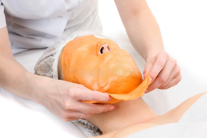 去除藻酸盐脱层面部面具 免版税库存图片