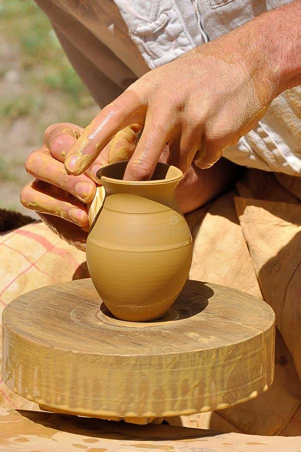 陶瓷工的手 库存图片
