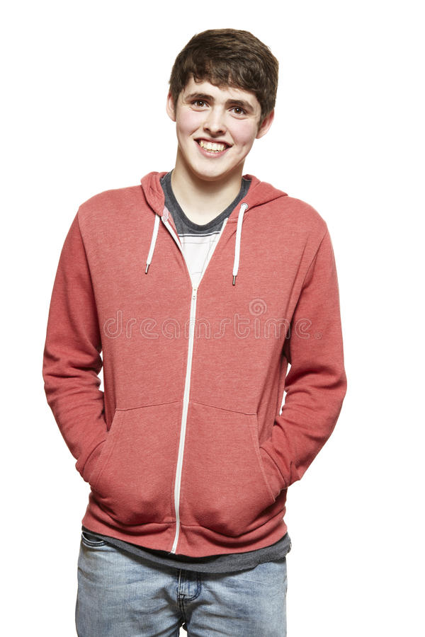 随便穿戴的十几岁的男孩微笑 库存图片