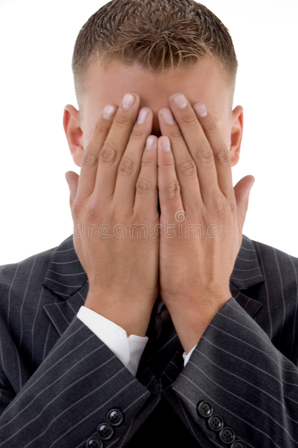 隐藏他害羞的生意人表面 免版税库存图片
