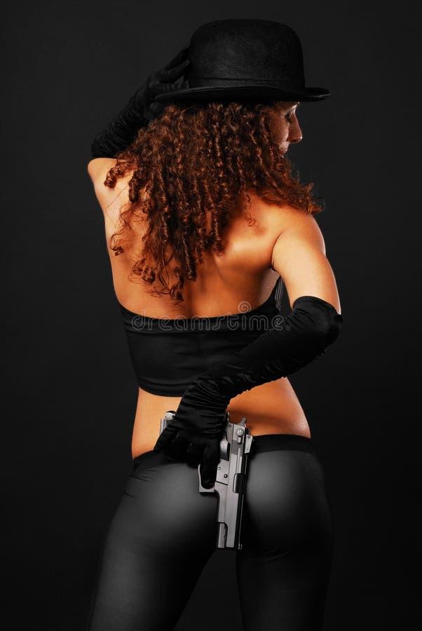 隐藏后方性感的视图的匪徒手枪 图库摄影