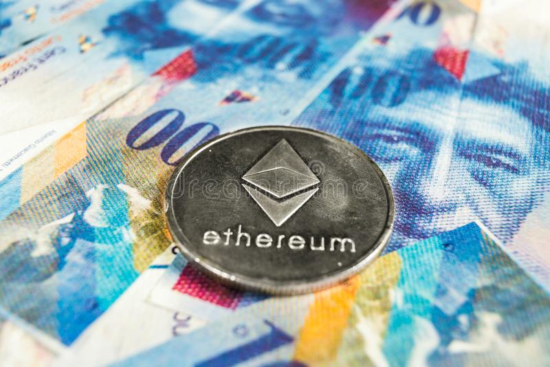 隐藏货币概念-与瑞士法郎货币的Ethereum,瑞士 库存照片