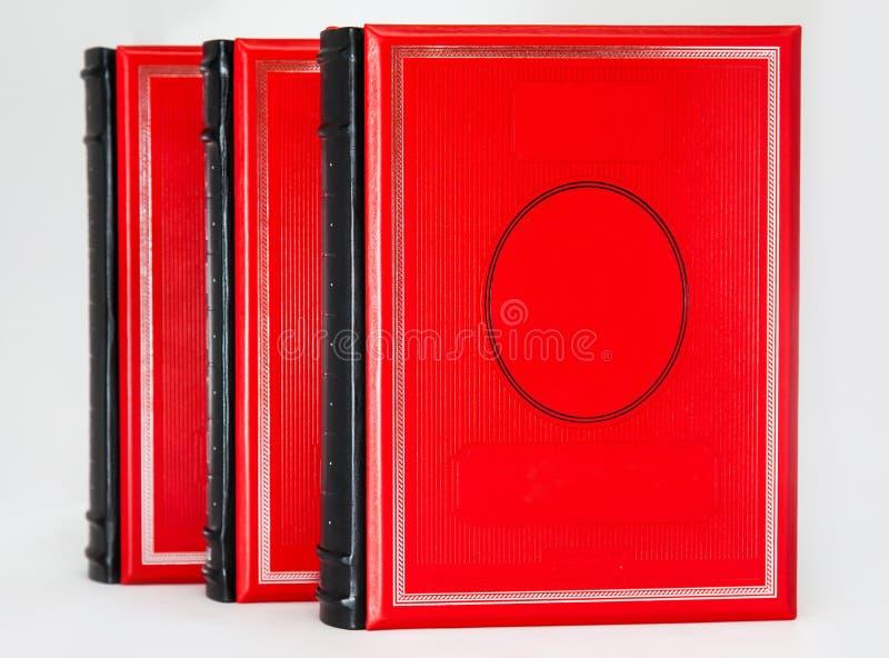 隔绝三本容量红色书 免版税库存照片